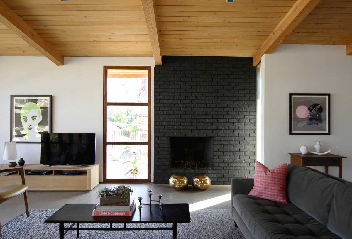 black brick fireplace design - Chino Canyon House