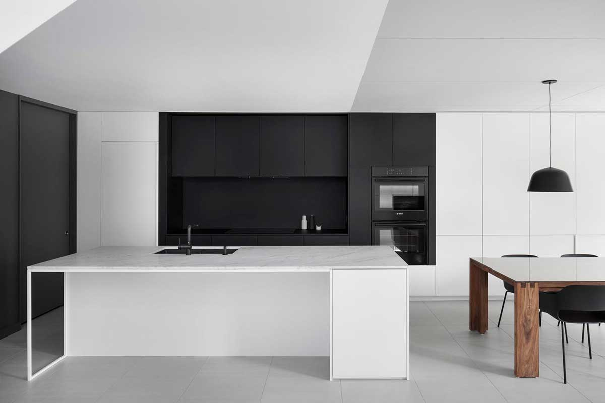 black white kitchen island - De la Roche Residence