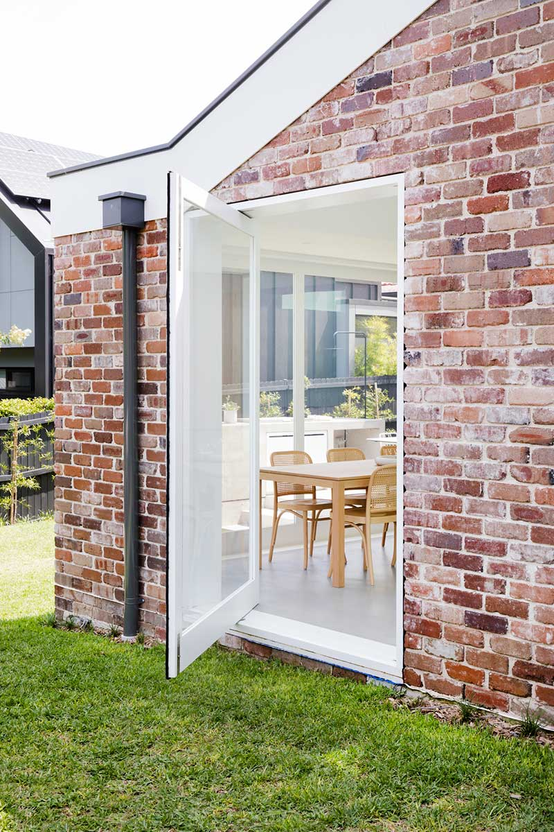 brick home extension pivot door design jl - Nat's House