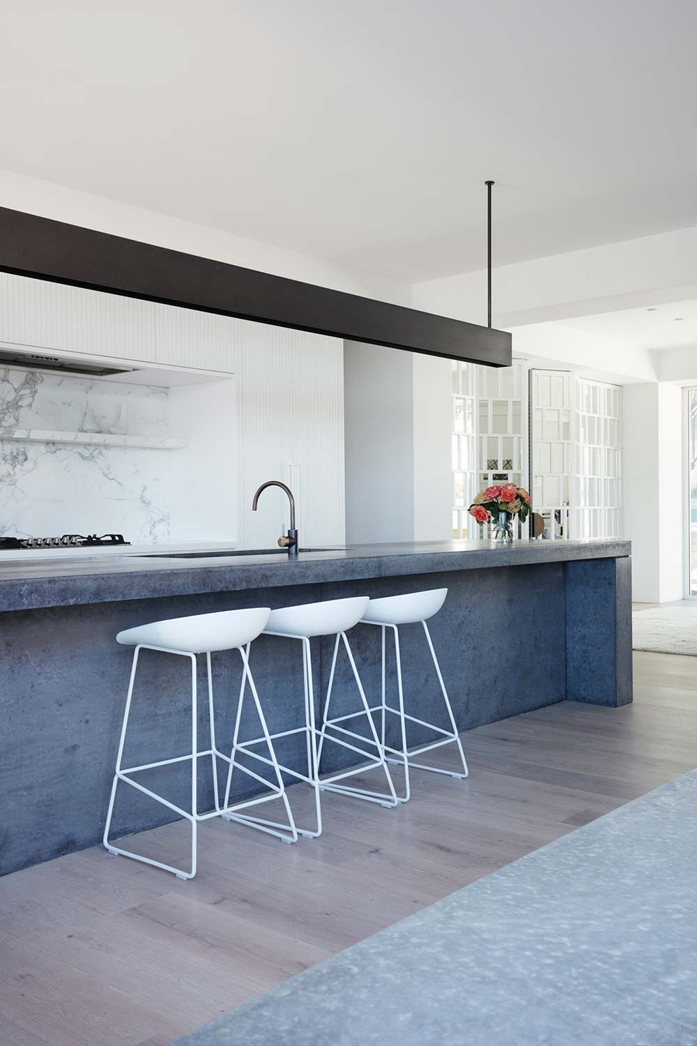 coastal home concrete kitchen island - Clovelly Residence