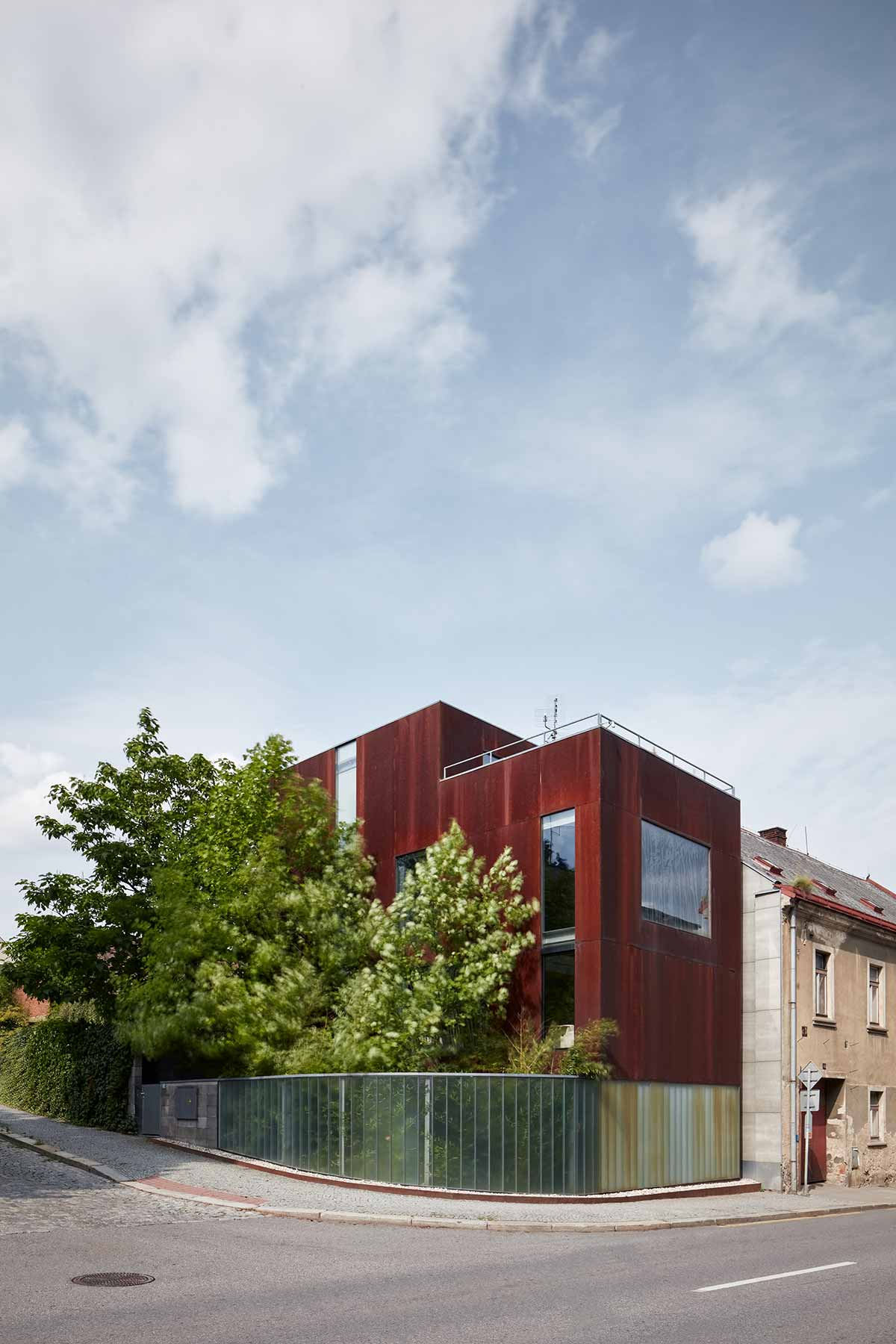 concrete corten house exterior okp - Rusty House