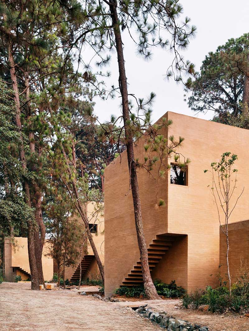 earth brick home design side - Entre Pinos