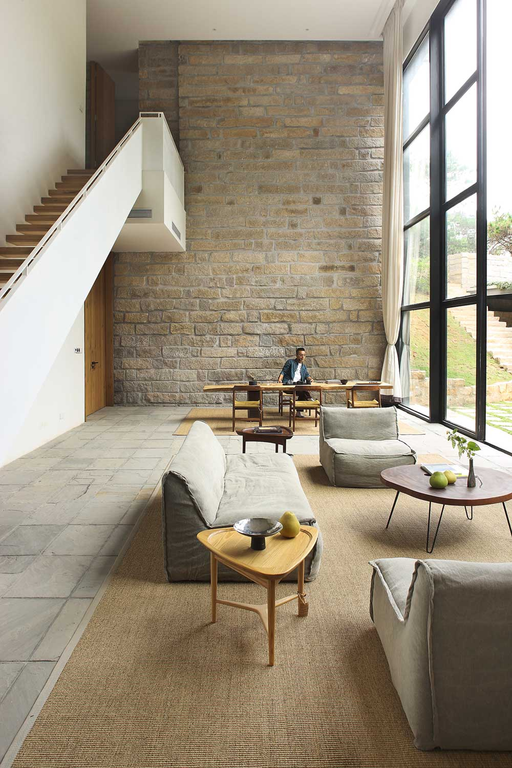 Double Height Living Room with Brick Wall