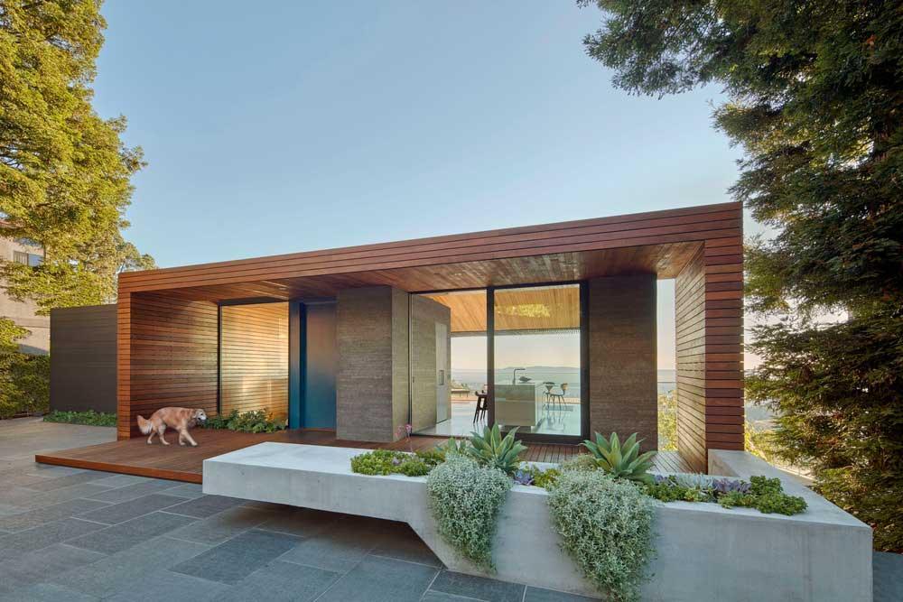 Modern home facade with concrete planter
