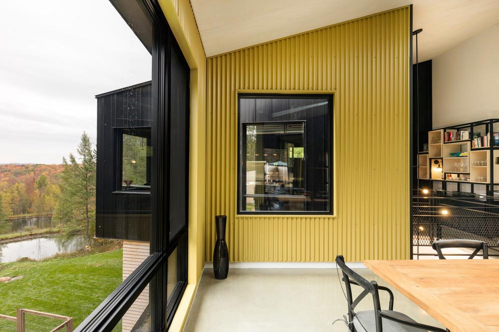 hillside home yellow wall design tux - Abercorn Chalet