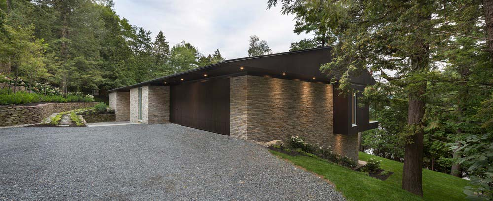 hillside lake house facade - The Slender House