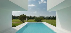 inner courtyard home pool ca 300x140 - Between Two White Walls
