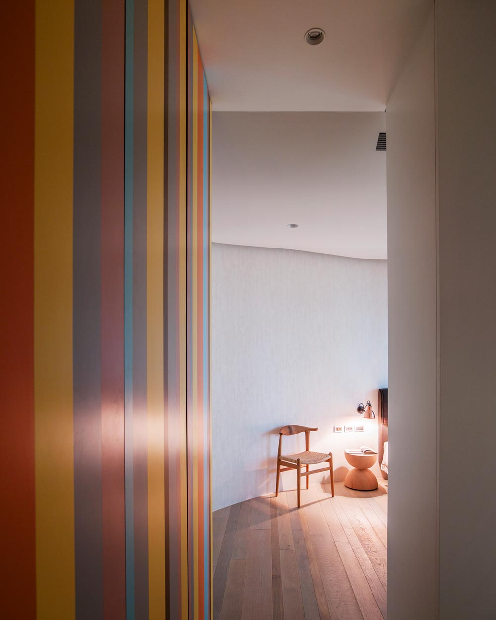 apartment interior design that flows with curved walls in