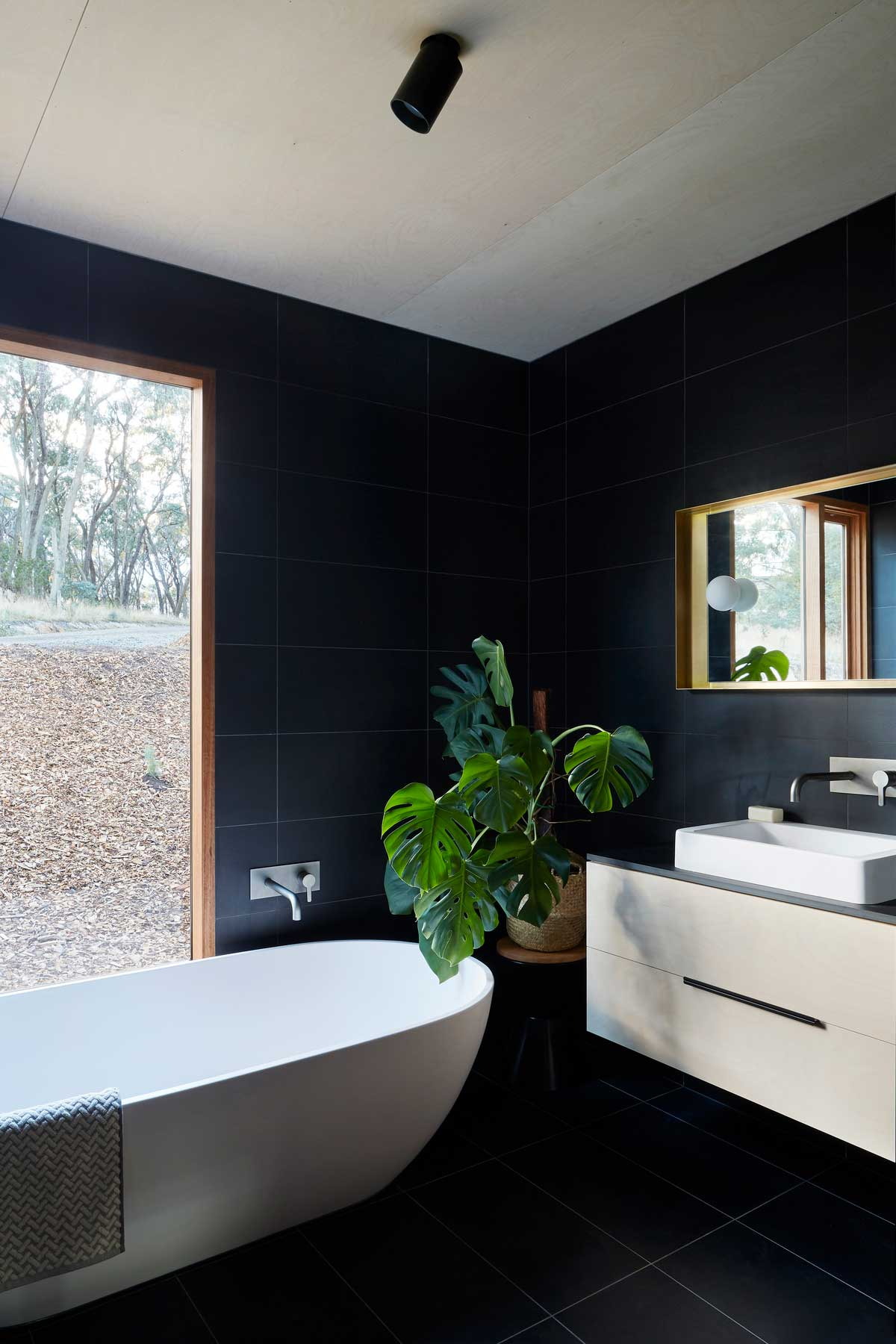 modern black bathroom design - Two Halves House