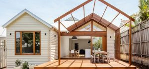modern cottage pergola deck 300x140 - Gable House