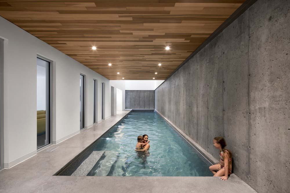 modern family lake house indoor pool - L'Accostée House