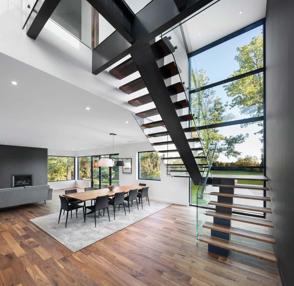 80 Awesome Modern Farmhouse Staircase Decor Ideas: Contemporary Farmhouse Design Mixes Wood Stone And Glass