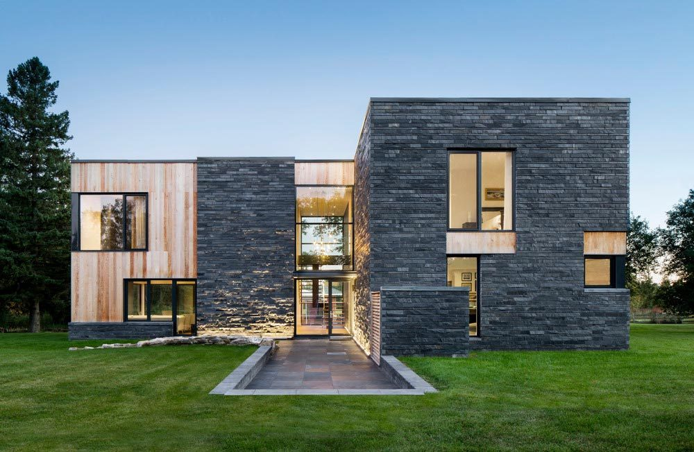 Contemporary Farmhouse Design Mixes Wood Stone And Gl