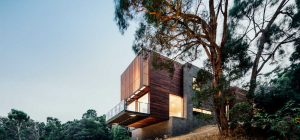 modern hillside house side 300x140 - Invermay House