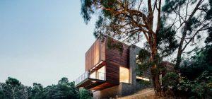 modern hillside house side 300x140 - Invermay House
