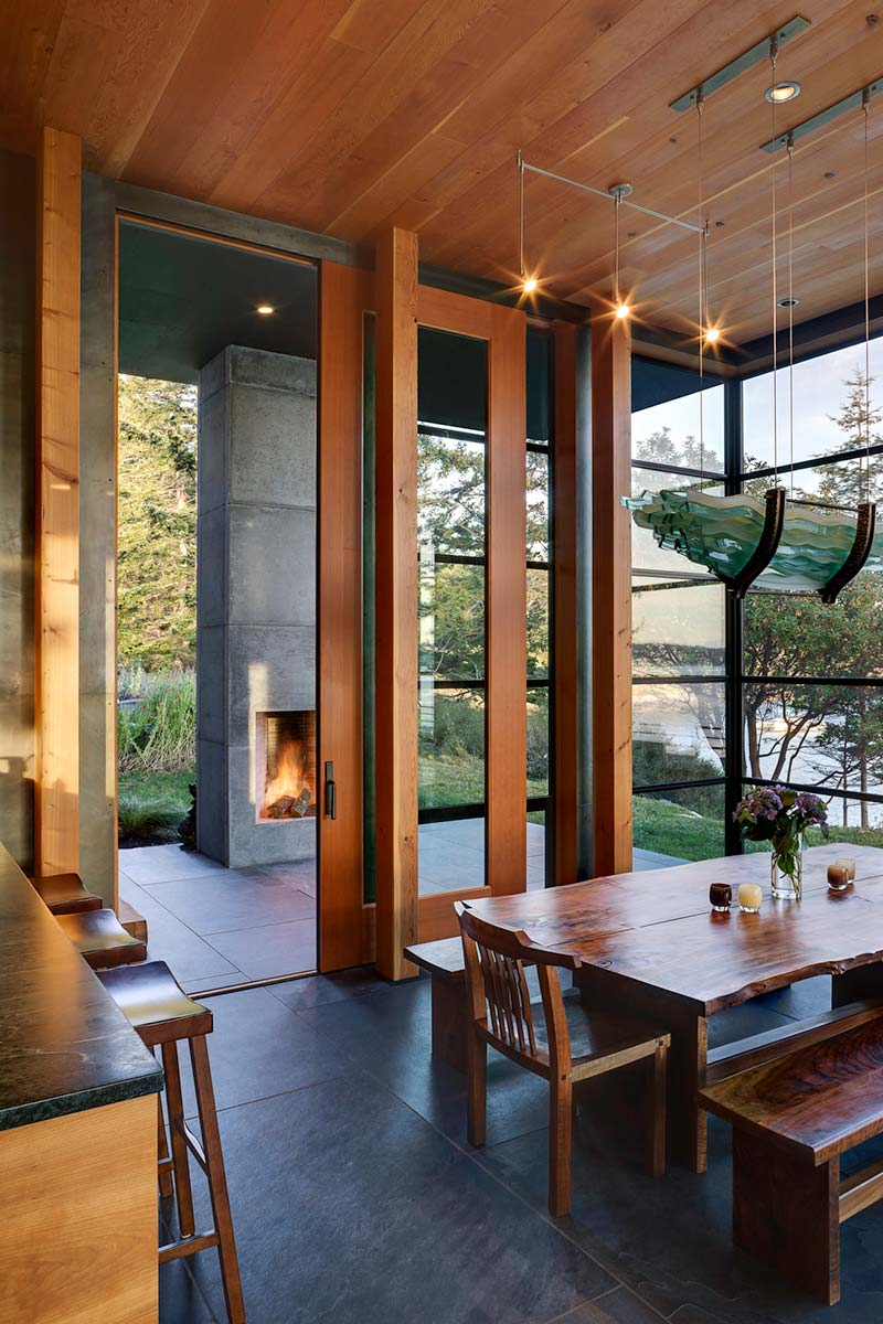 modern island cabin outdoor fireplace - North Bay Residence