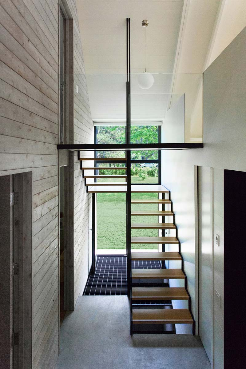 modern lake cottage staircase - Window on the Lake