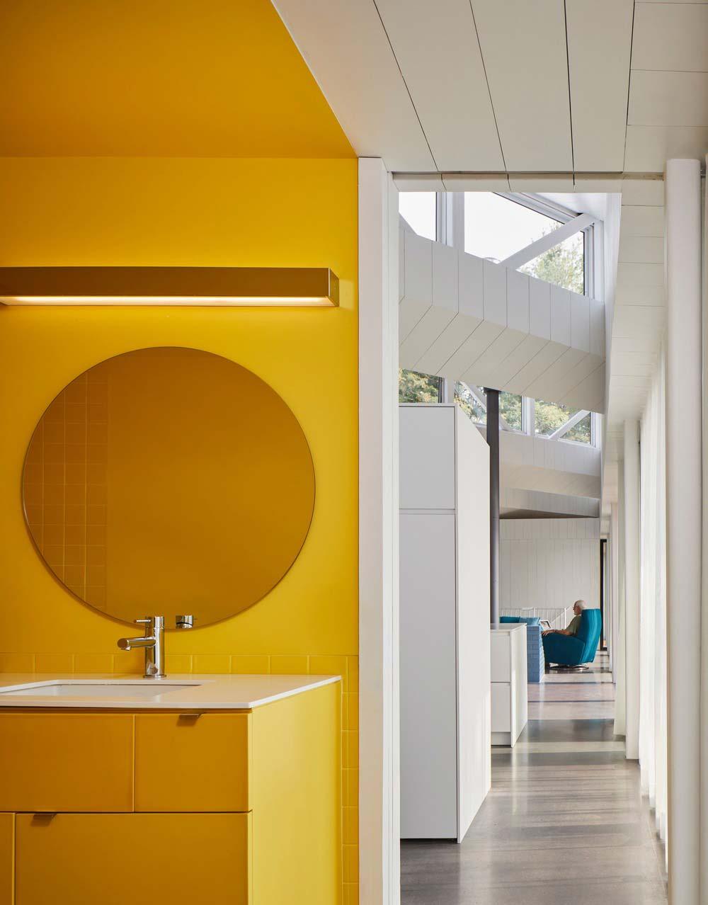 modern lake house yellow bathroom - Sky House