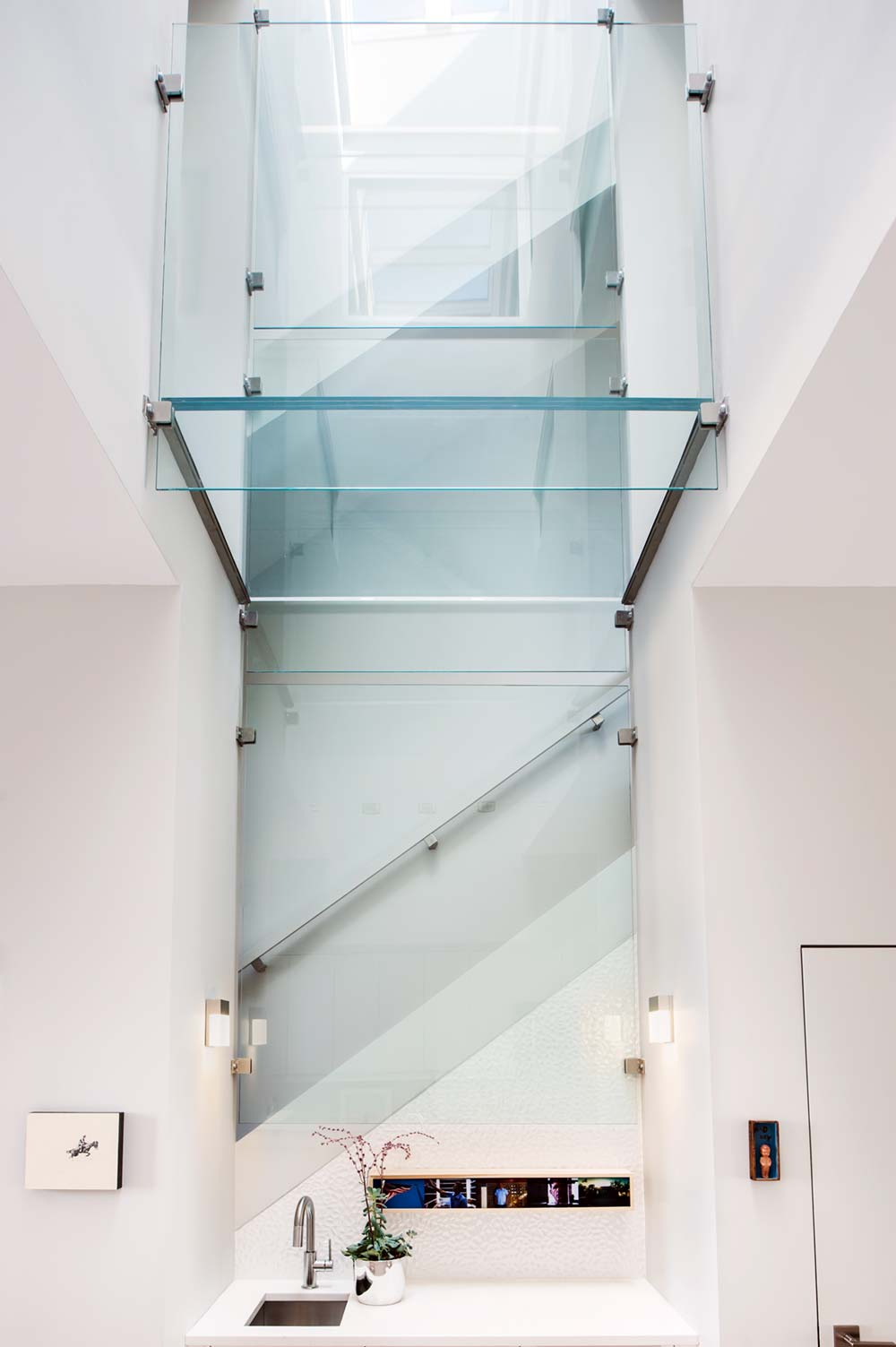 modern row house skylight glass floor