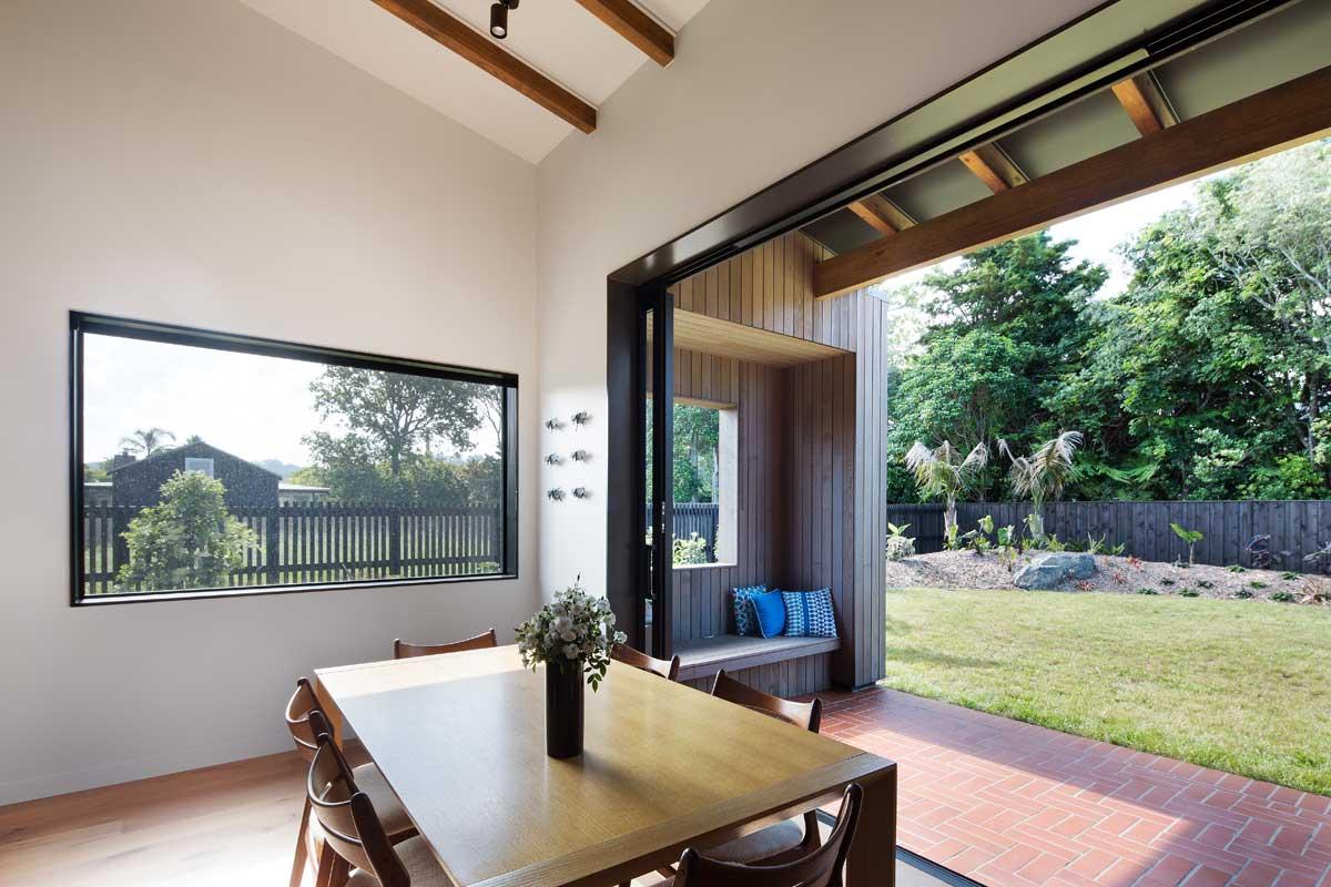 modern split level home dining - House Under Eaves