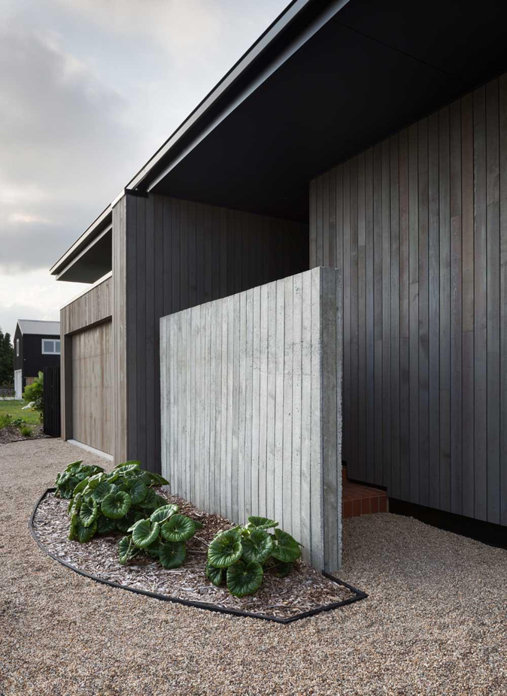 modern split level home entrance - House Under Eaves