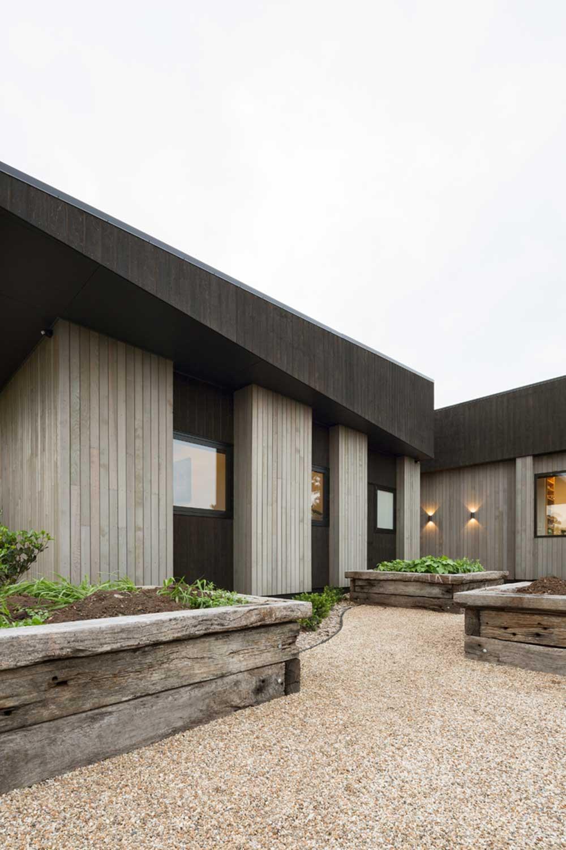 modern split level home exterior - House Under Eaves