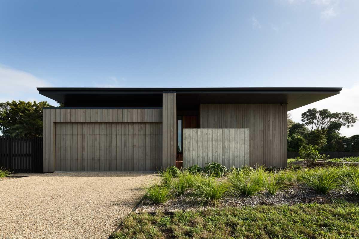 modern split level home facade - House Under Eaves