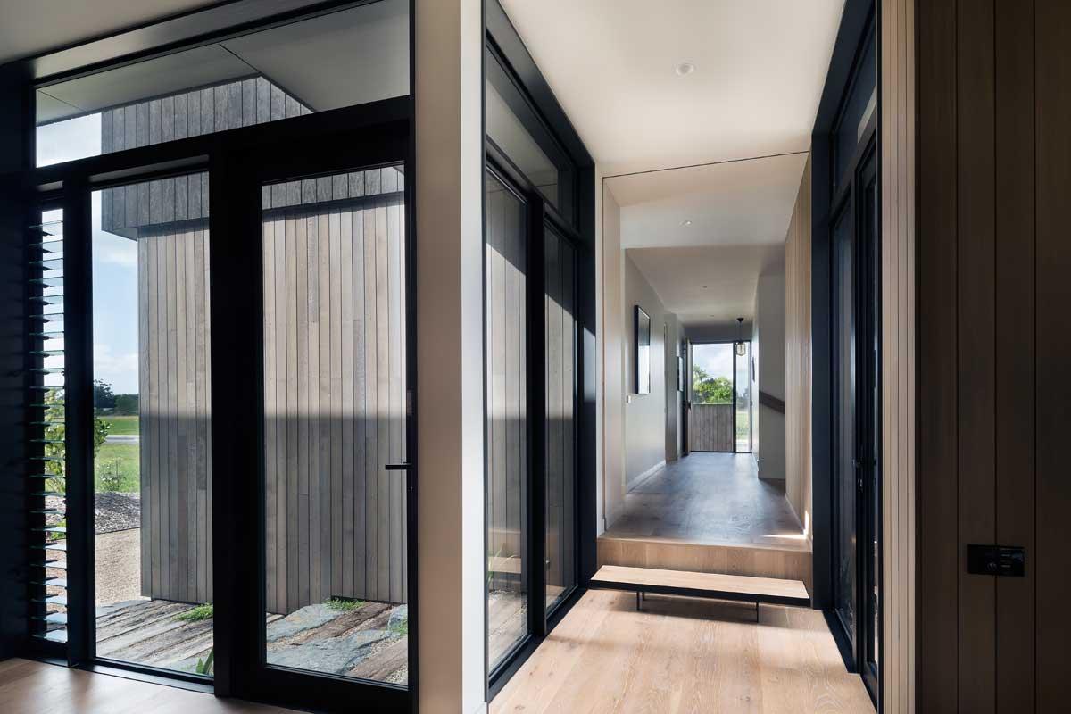 modern split level home windows - House Under Eaves