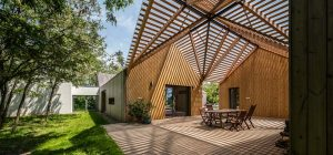 modern wooden house pergola arc2 300x140 - Modern Wooden House