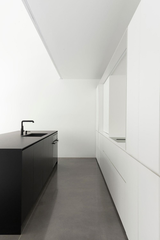 Narrow lot home modern black & white kitchen design