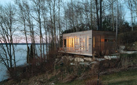 prefab-cabin-lake-sunset