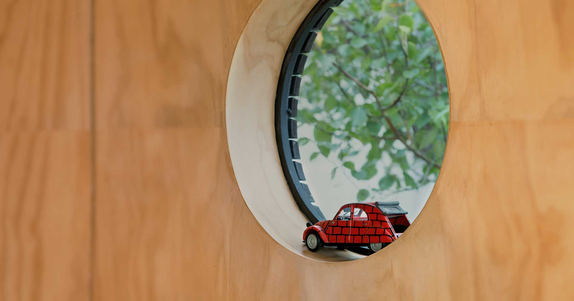 Small prefab cabin round window