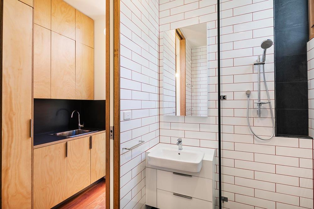 Prefab home small bathroom with shower
