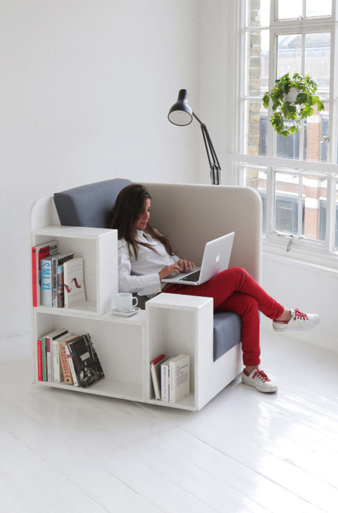 Reading chair with integral shelving and journal hangers