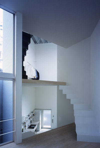 small narrow house w 4 - W Window House: a shimmering steel tower