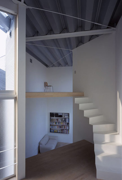 small narrow house w 6 - W Window House: a shimmering steel tower