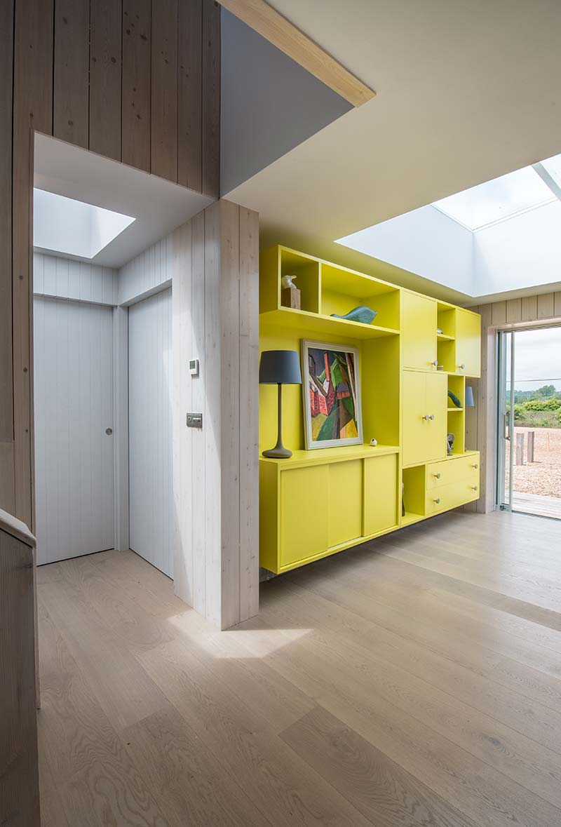 sustainable home yellow cabinet - Chalfont Beach House