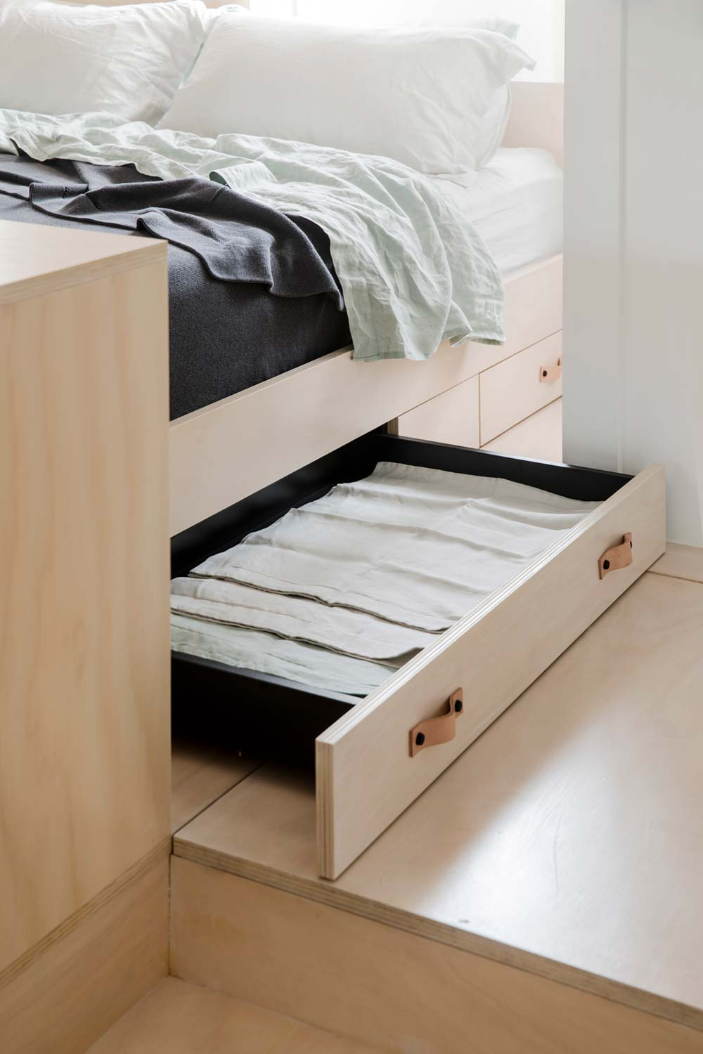 Tiny apartment under bed storage drawer