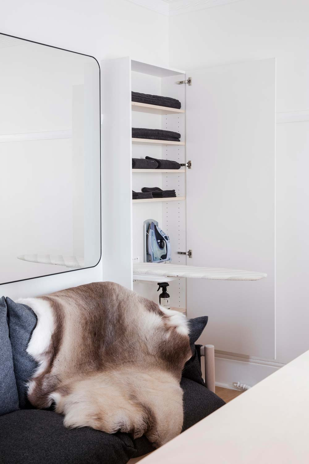 Tiny apartment storage ironing board cupboard