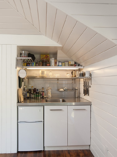 Tiny carriage house conversion small spaces Studio apartment kitchen