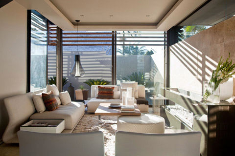 Modern Villa- Entrance hall gives access to a lounge area before arriving to a double-height social zone