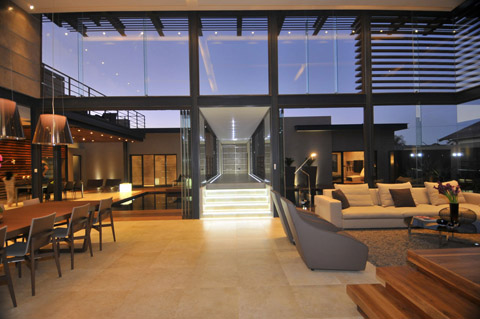 Villa renovation -  Living and dining rooms with direct relation to the outdoor garden and swimming pool.