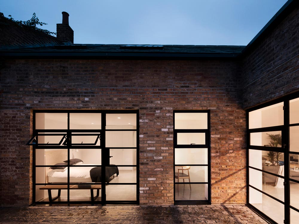 warehouse home courtyard design - Defoe Road Warehouse Conversion